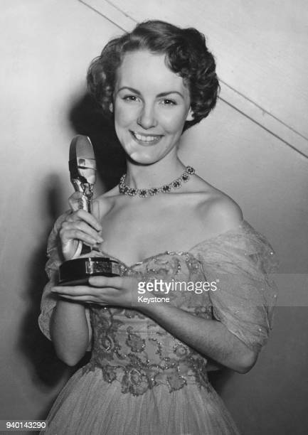 British actress and singer Petula Clark wins a silver microphone at the National Radio and Television Awards at Grosvenor House, London, 5th December...