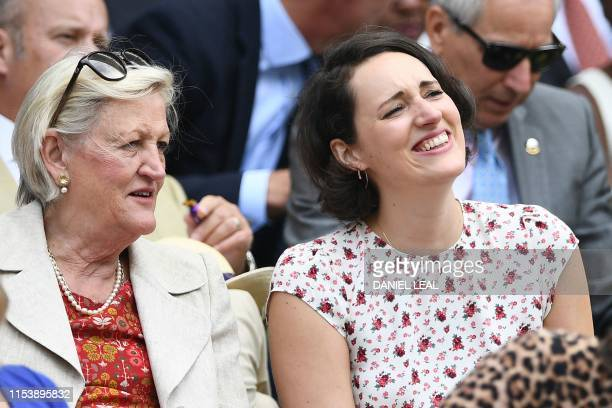 British actress and writer Phoebe WallerBridge sits in the Royal Box on Centre Court to watch South Africa's Kevin Anderson play against Argentina's...