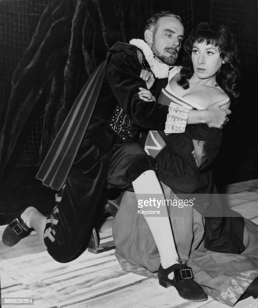 British actress Ann Lynn as Winnifride endures the unwelcome advances of Edward Jewesbury as Sir Arthur Clarington during rehearsals for the Jacobean...