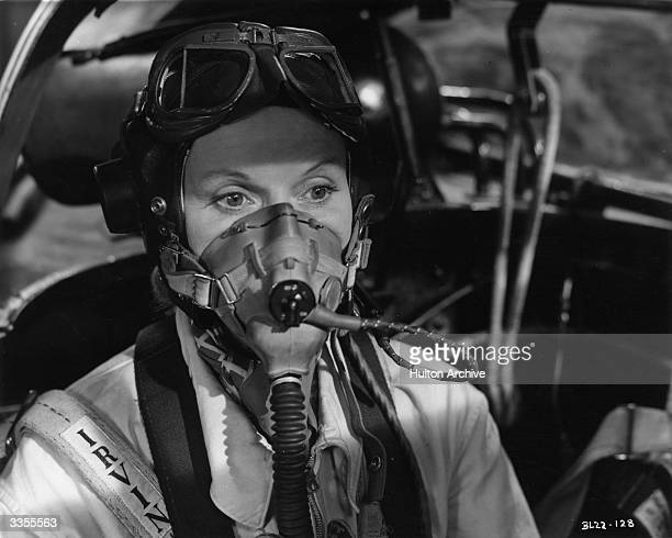 British actress Ann Todd sits in the cockpit of an aircraft in the film 'The Sound Barrier' written by Terence Rattigan The film was directed by...
