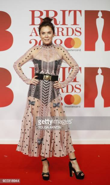 British actress Anna Friel poses on the red carpet on arrival for the BRIT Awards 2018 in London on February 21 2018 / AFP PHOTO / Tolga AKMEN /...