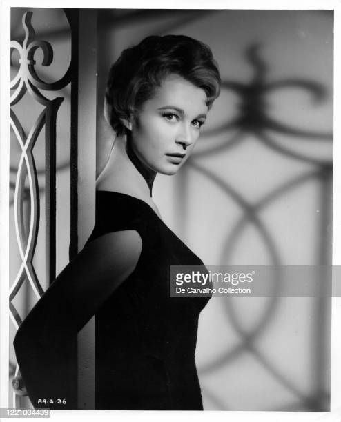 British actress Anne Aubrey as 'Jane Carlton' in a black dress in a publicity shot from the movie 'Killers Of Kilimanjaro' United Kingdom