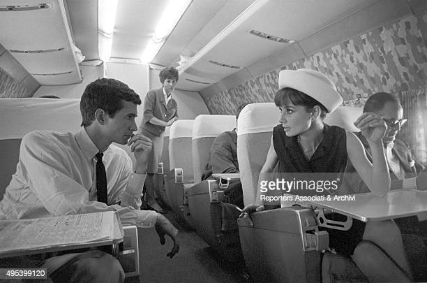 British actress Audrey Hepburn and American actor Anthony Perkins chatting on the airplane leading them to the David di Donatello Awards ceremony...
