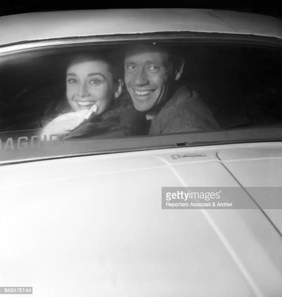 British actress Audrey Hepburn and American actor Mel Ferrer smiling inside a car Ciampino 1958