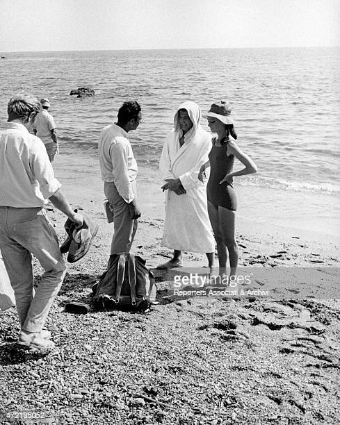 British actress Audrey Hepburn and British actor Albert Finney being directed by American director Stanley Donen on the set of the film Two for the...
