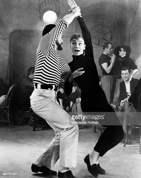 British actress Audrey Hepburn dancing in the film Funny Face. Paris, 1956