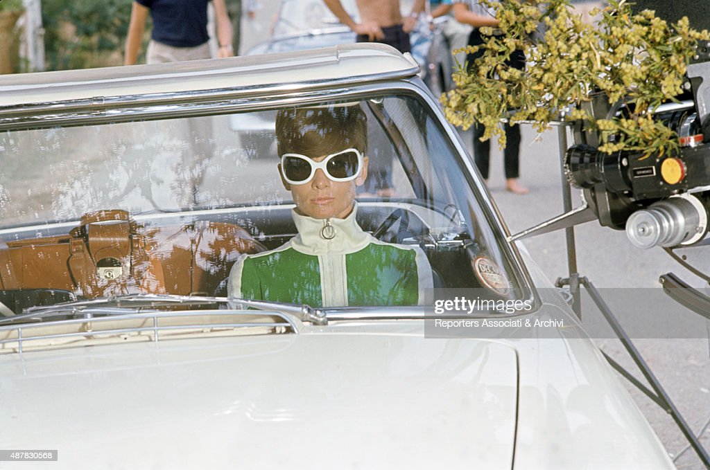 British actress Audrey Hepburn in a car on the set of Two For the Road. 1967