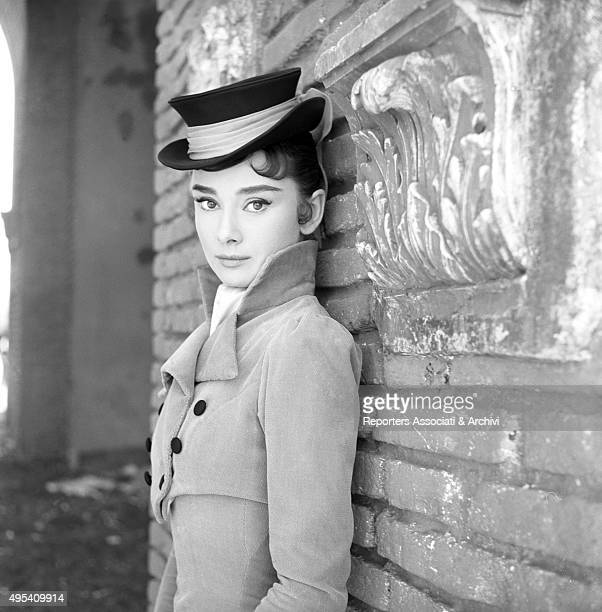 British actress Audrey Hepburn posing wearing a hat on the set of the film War and Peace. 1955