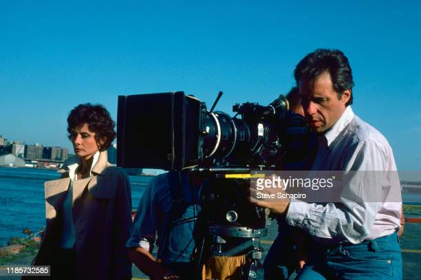 British actress Audrey Hepburn stands by as American film director Peter Bogdanovich looks through the camera lens on the set of their film 'They All...