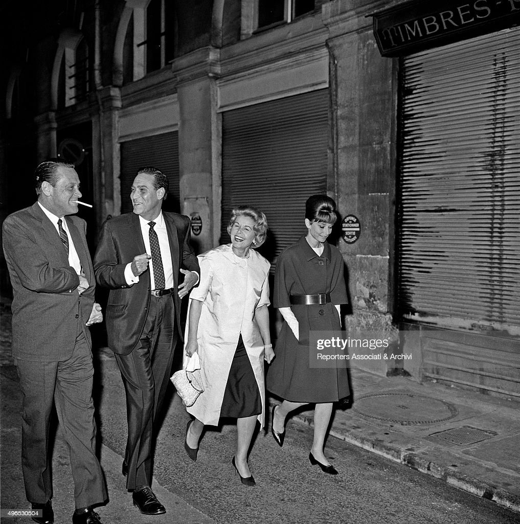 British actress Audrey Hepburn walking in the streets of Paris with American William Holden (William Franklin Beedle Junior), German actor Curd Jurgens (Curd Gustav Andreas Gottlieb Franz Jürgens) and a woman. Paris,