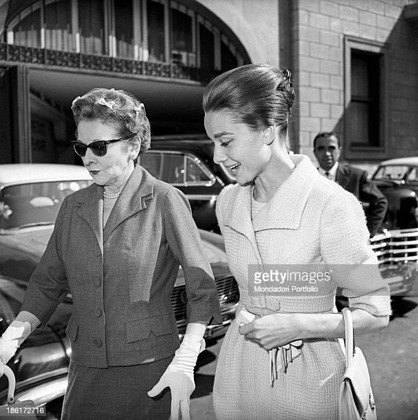 British actress Audrey Hepburn walking with her mother, the Dutch baroness Ella Van Heemstra. Rome, 1950s.