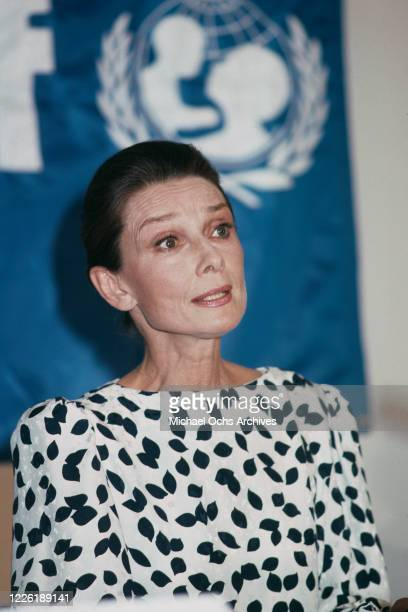 British actress Audrey Hepburn , wearing a white top with a black leaf pattern, attends the UNICEF Honours Audrey Hepburn ceremony, held at the...