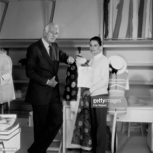 British actress Audrey Hepburn with French fashion designer Hubert de Givenchy in his workshop in Paris