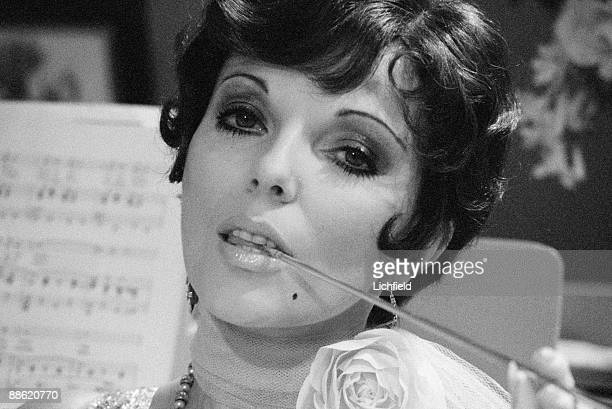 British actress authoress and columnist Joan Collins photographed in character on the television set of the Orson Welles' Great Mysteries programmes...