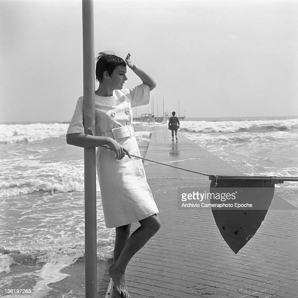 British actress Barbara Steele posing for the photographers on the Lido beach Venice circa 1960