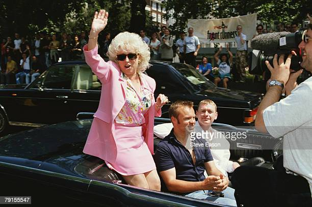 British actress Barbara Windsor waving during Lesbian, Gay, Bisexual, and Transgender Pride, 5th July 1997. She shares a car with comedian and...