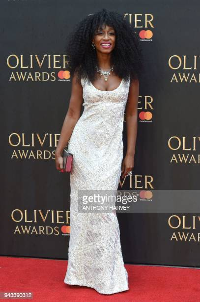 British actress Beverley Knight poses on the red carpet upon arrival to attend The Olivier Awards at the Royal Albert Hall in central London on April...