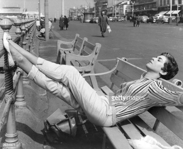 British actress Billie Whitelaw relaxing on the front at Blackpool where she is starring 'Progress In The Park'. Original Publication: People Disc -...