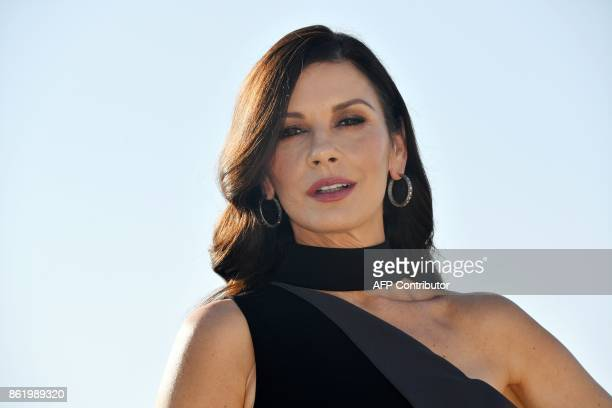 British actress Catherine ZetaJones for a photograph during the MIPCOM trade show in Cannes southern France on October 16 2017 / AFP PHOTO / YANN...