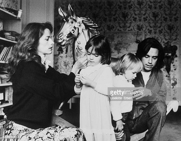 British actress Charlotte Rampling and composer JeanMichel Jarre at home with their children