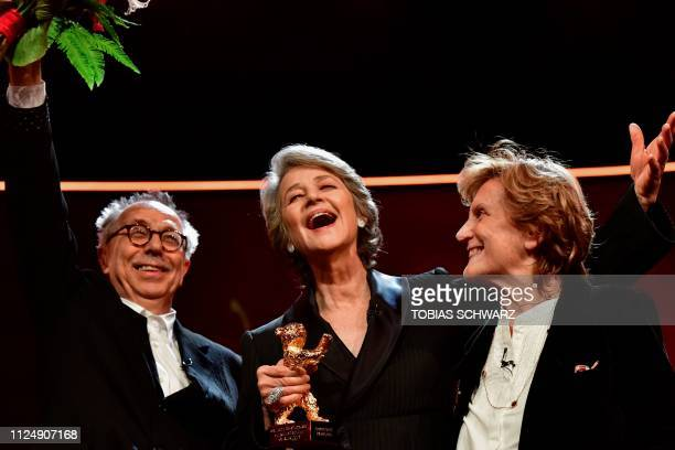TOPSHOT British actress Charlotte Rampling holds her Honorary Golden Bear next to Director of the Berlinale Film Festival Dieter Kosslick and Italian...