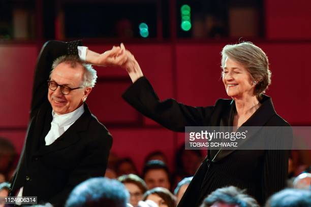 British actress Charlotte Rampling is lead by Director of the Berlinale Film Festival Dieter Kosslick before receiving an Honorary Golden Bear during...