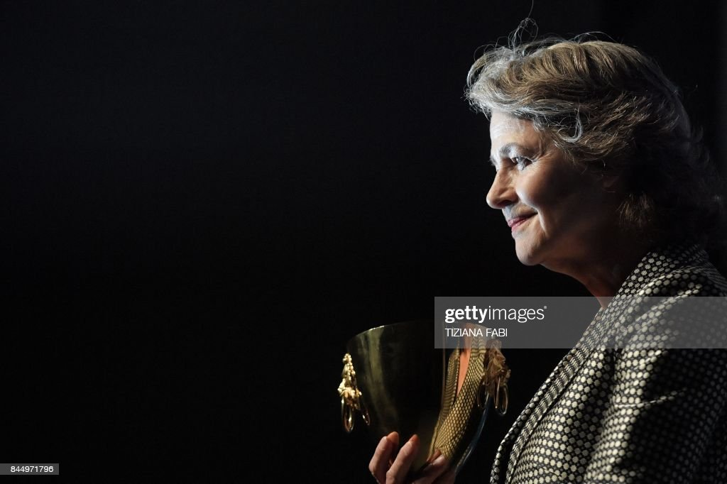 British actress Charlotte Rampling poses during a photocall after she receives the Coppa Volpi for Best Actress for her character in the movie 'Hannah' during the award ceremony of the 74th Venice Film Festival on September 9, 2017 at Venice Lido. / AFP PHOTO / Tiziana FABI