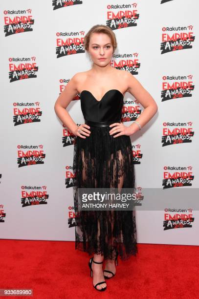 British actress Ciara Charteris poses arriving for the 23rd annual Empire Awards in London on March 18 2018 / AFP PHOTO / Anthony HARVEY