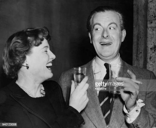 British actress Constance Cummings toasts actor Henry Kendall on his 35 years on the stage as he celebrates with a party at the Comedy Theatre 21st...