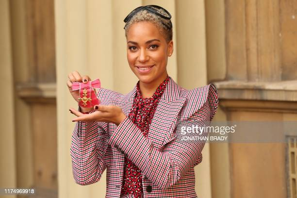 British actress Cush Jumbo poses with her medal and insignia after she was appointed an Officer of the Order of the British Empire at an investiture...