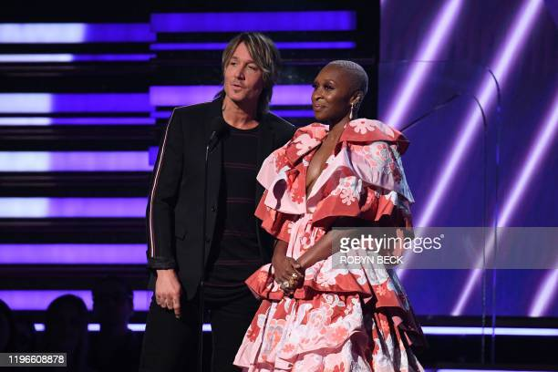 British actress Cynthia Erivo and Australian singersongwriter Keith Urban present the award for Best Pop Solo Performance during the 62nd Annual...