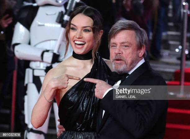 TOPSHOT British actress Daisy Ridley and US actor Mark Hamill pose on the red carpet for the European Premiere of Star Wars The Last Jedi at the...