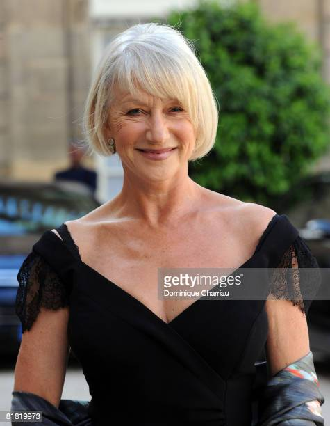 British actress Dame Helen Mirren poses in the courtyard of the Elysee Palace before attending a ceremony at the president's official residence for...
