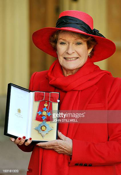 British actress Dame Janet Suzman proudly holds her Dame CBE after she received it from Queen Elizabeth II at Buckingham Palace London on November 30...