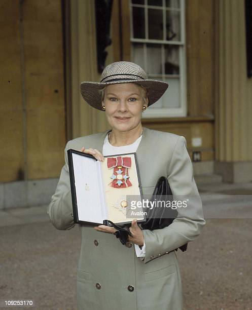 British Actress Dame Judi Dench Outside Buckingham Palace after receiving her DBE