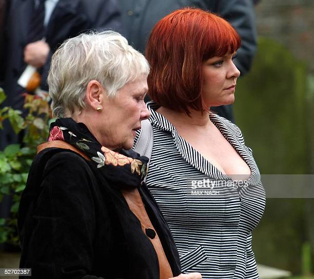 British actress Dame Judy Dench accompanied by her daughter Vinty leaves the church of St Mary The Virgin in Denham after attending the funeral of...