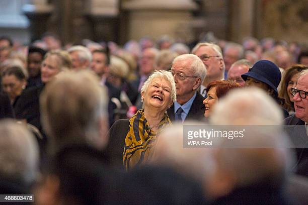 British actress Dame Judy Dench laughs at a joke made by Lord Puttnam at a service of thanksgiving for the life and work of Lord Attenborough CBE at...