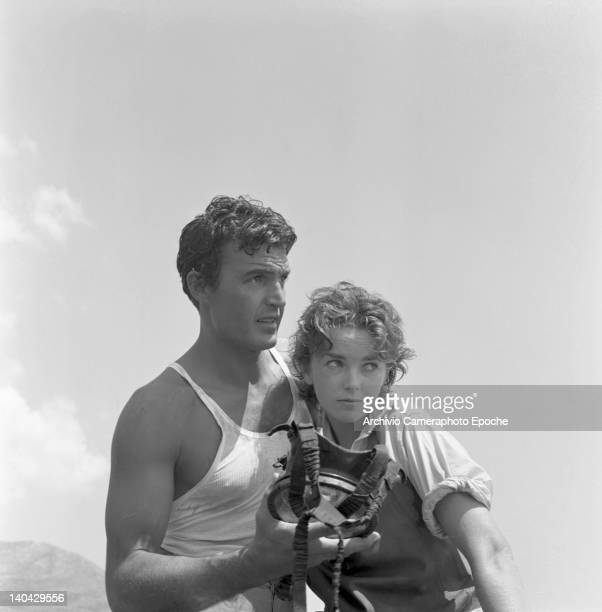 British actress Dawn Addams wearing a scuba diver gear on the Mizar movie set with Franco Silva 1953