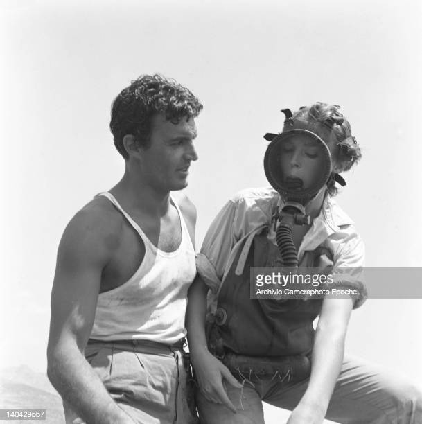 British actress Dawn Addams wearing a scuba diver gear on the Mizar movie set with Franco Silva 1953