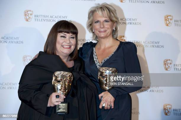 British actress Dawn French and Jennifer Saunders pose with their Fellowship British Academy Television Award in Central London on April 26, 2009....