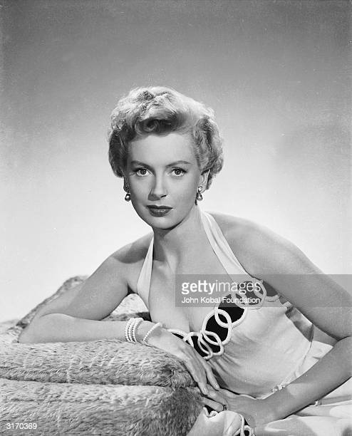 British actress Deborah Kerr in the costume for her role in 'From Here to Eternity' where she played a passionate adulteress having an affair with...