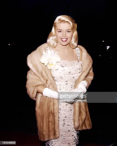 British actress Diana Dors in a fur coat, circa 1955.