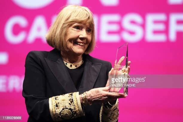 British actress Diana Rigg poses after receiving the Icon Award during the opening ceremony of the 2nd edition of the Cannes International Series...