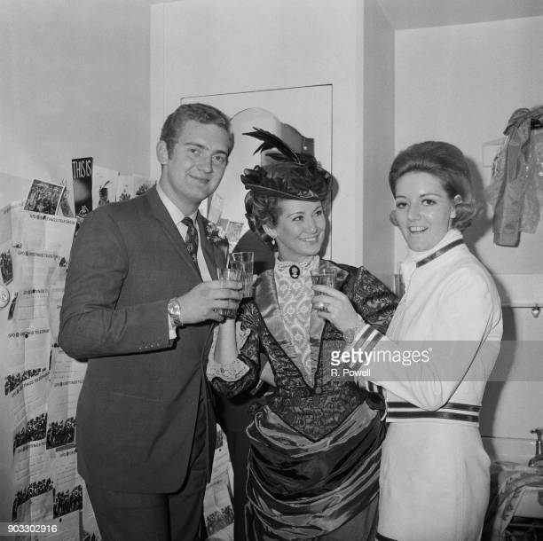 British actress Dinah Sheridan toasting his son Conservative Party politician Jeremy Hanley and his wife Helene Mason UK 22nd September 1968