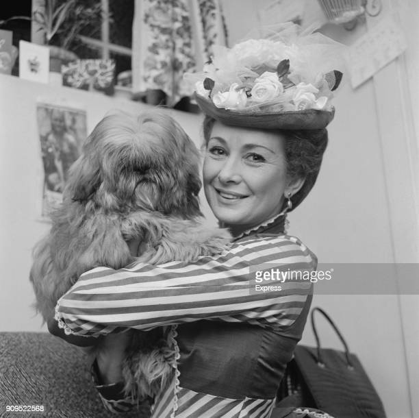British actress Dinah Sheridan wearing period costume holds her dog at the Duchess Theatre London UK 29th December 1968