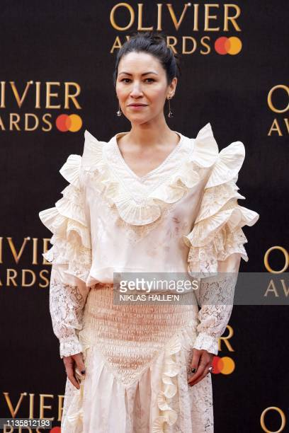 British actress Eleanor Matsuura poses on the red carpet upon arrival to attend The Olivier Awards at the Royal Albert Hall in central London on...
