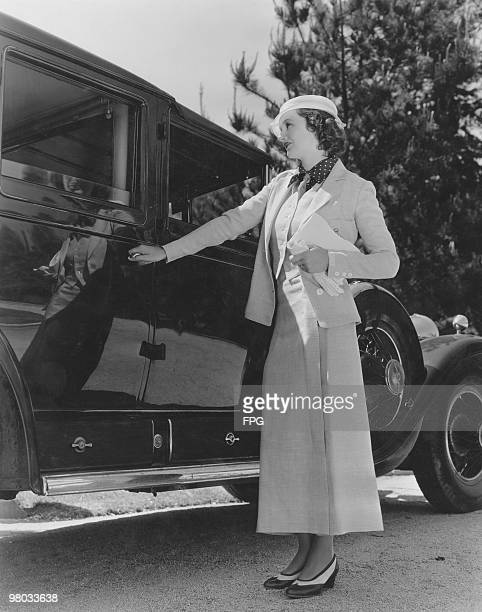 British actress Elizabeth Allan wearing a threepiece linen suit and twotone shoes California 1933