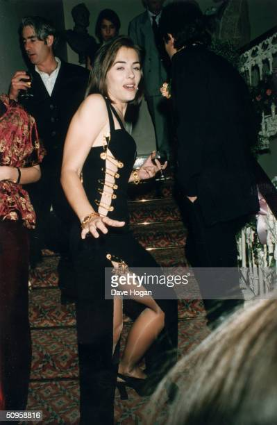 British actress Elizabeth Hurley attends the London post-premiere party of her boyfriend Hugh Grant's latest film, 'Four Weddings and a Funeral'...