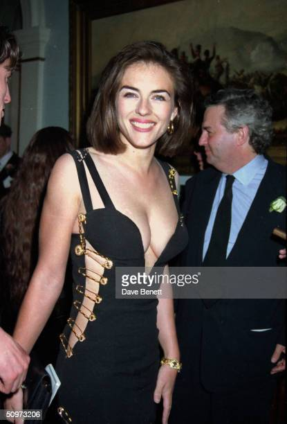 "British actress Elizabeth Hurley attends the post-premiere party of her boyfriend Hugh Grant's latest film, ""Four Weddings And A Funeral"" on May 11,..."
