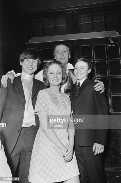 British actress Elizabeth Power with English actor and singer Edward Woodward , co-stars in the musical 'Two Cities, with Woodward's sons Tim and...